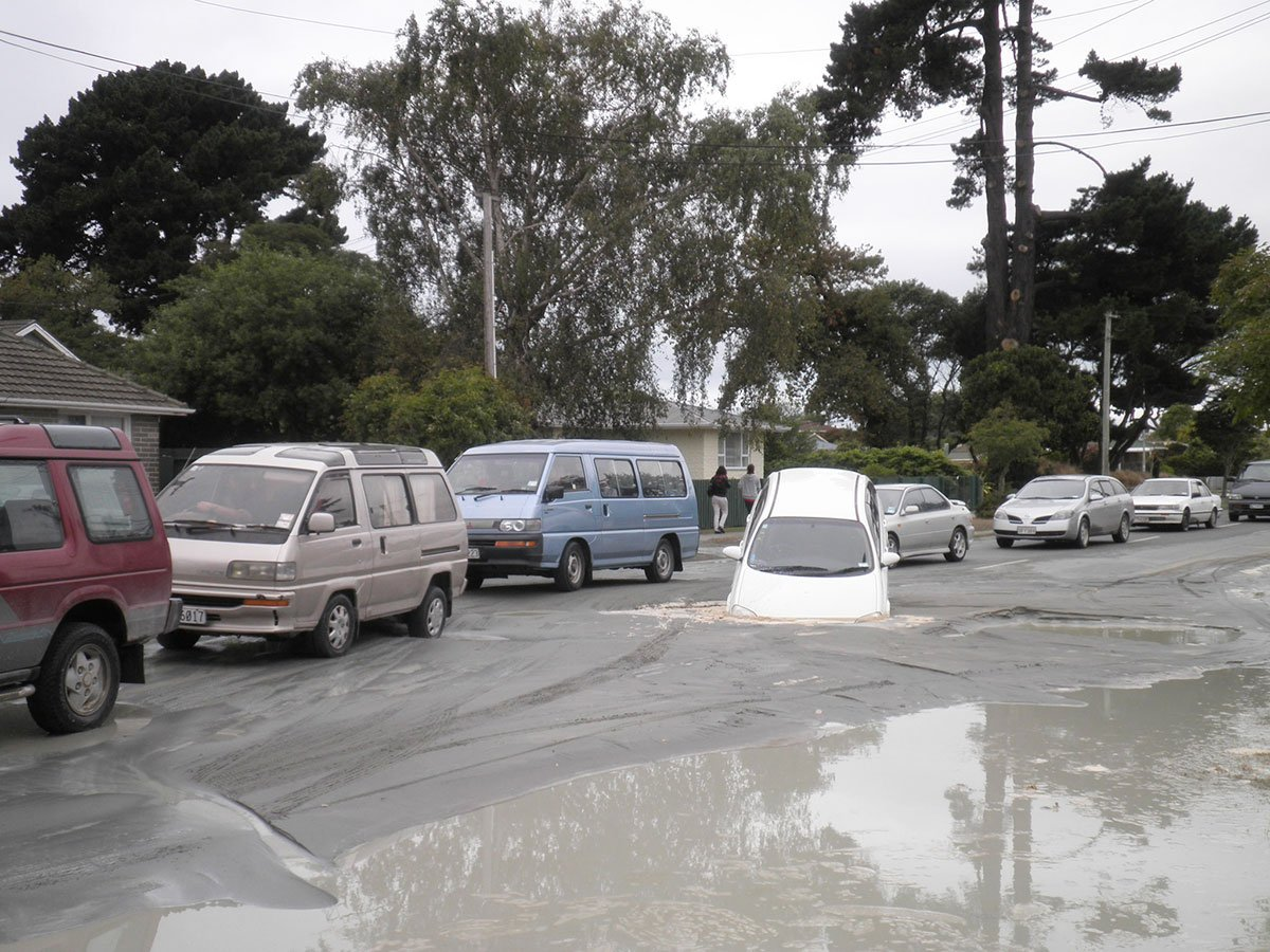 A white station wagon in liquefaction on Pages Road