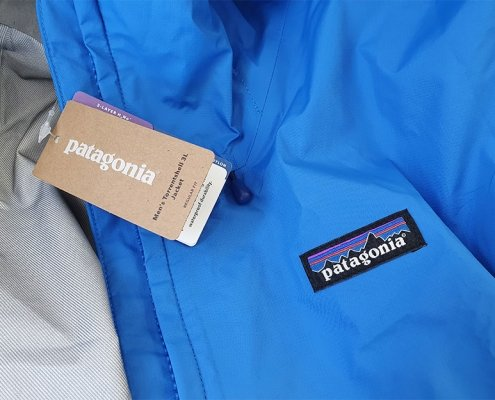 The Patagonia Torrentshell 3L rain jacket in Andes Blue